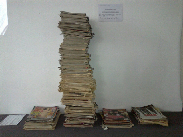 'For Whatever Reason'..(Access); Annie Gardiner, 2012 Installation of copies of NME magazine from 1989-2008. Piles of magazines divided by gender of artists depicted on the cover, as follows: Woman - Man - Both - None